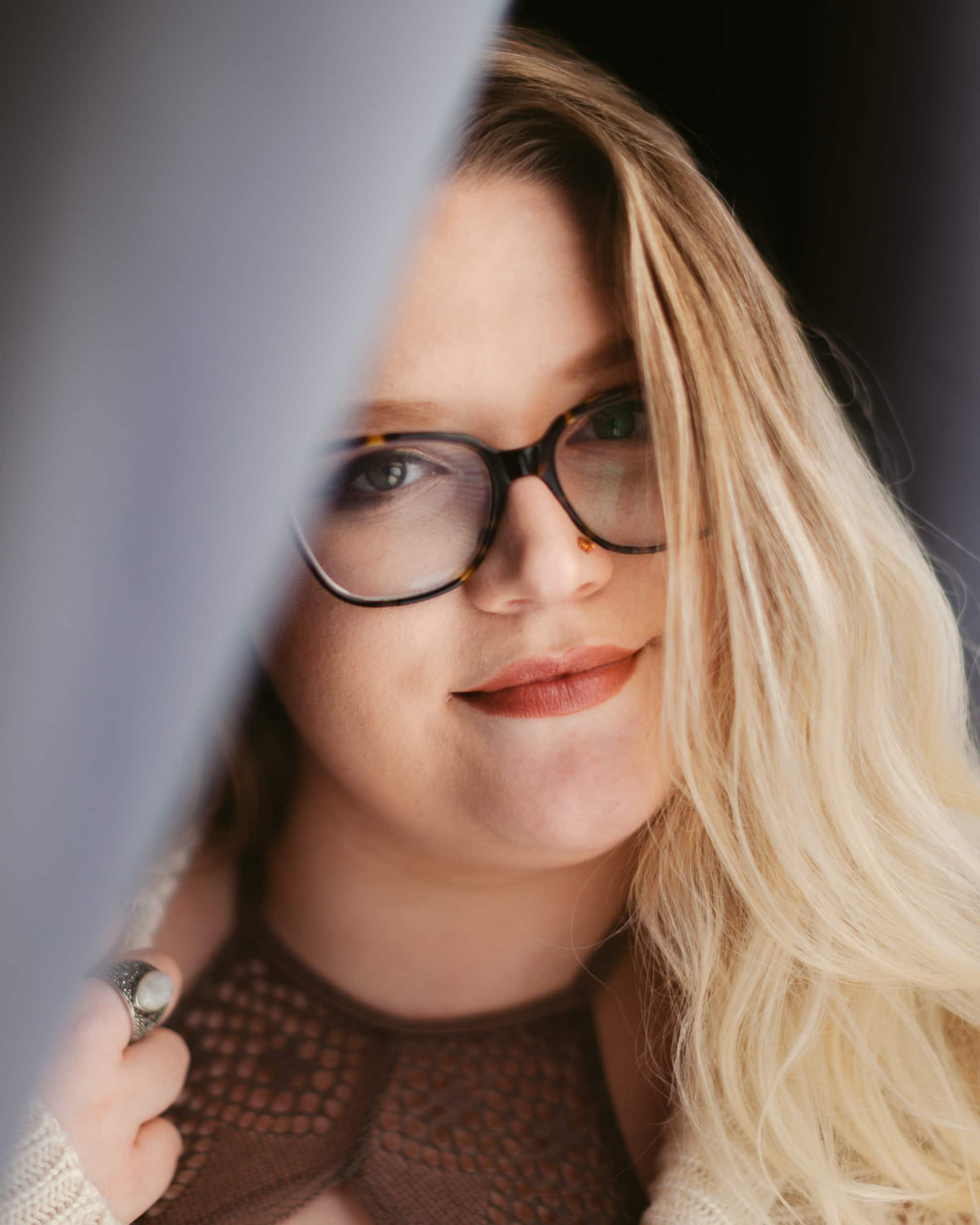 Blond woman wearing glasses
