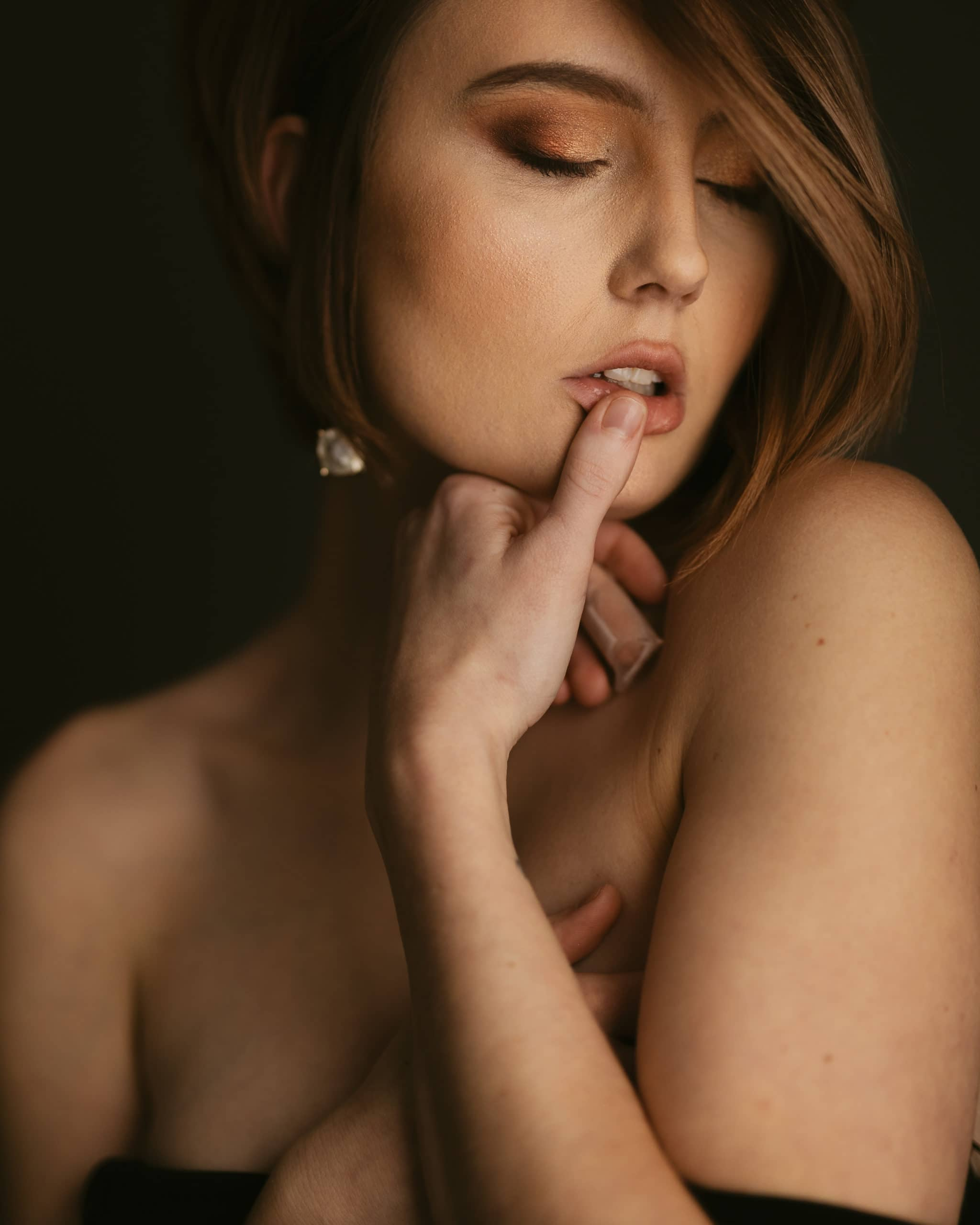 Woman with finger on her lip