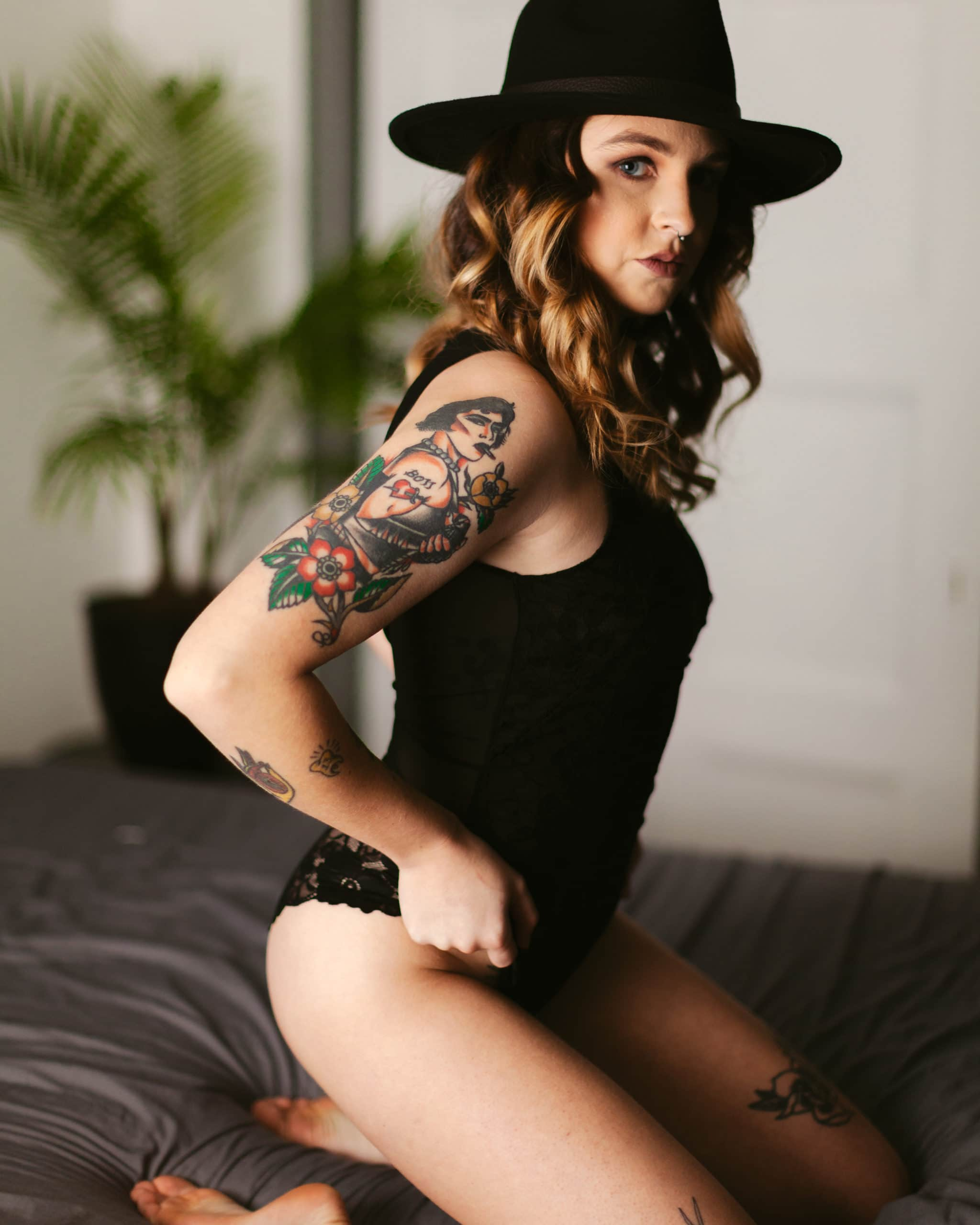 Woman wearing a bodysuit and hat