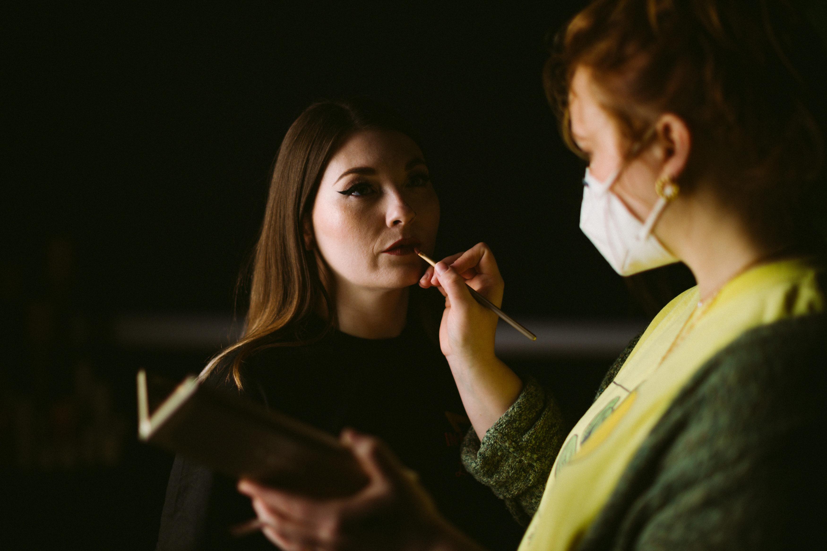Makeup artist doing make up on a woman